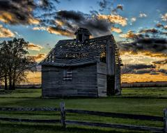Sunset behind a Prairie Corn Crib